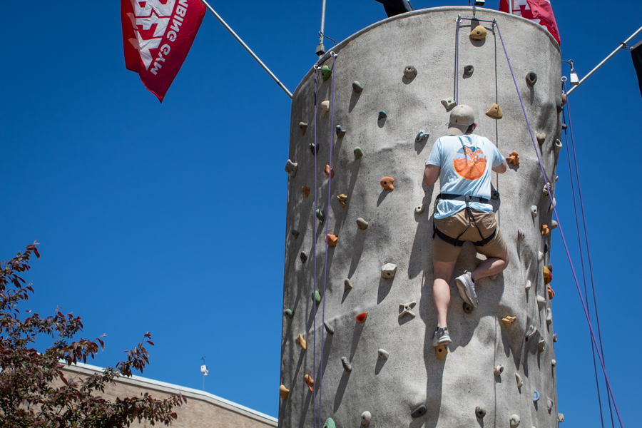As Kort closes in on the top, he prepares to ring the bell to show the completion of his climb.