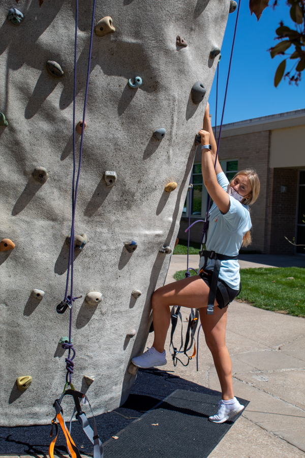 Senior Abby Bird starts her ascent up the wall.