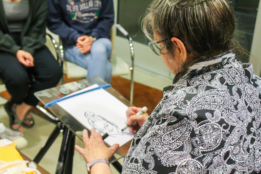 The caricature artist draws caricatures for Baker students. This was one of the many offerings during the study break organized by Student Activities Council (SAC).