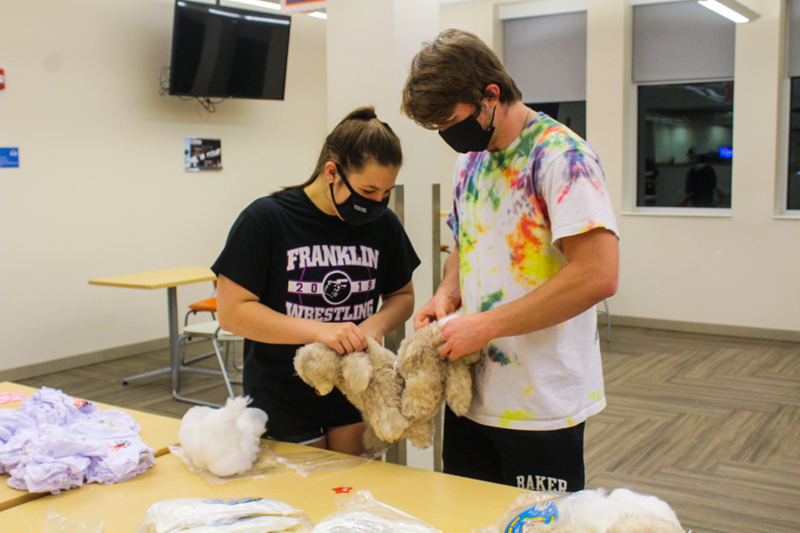 Freshmen Taylor Proffit and Connor Keith making Baker Build-A-Bears at one of the study break tables. This has been a recurring finals week activity for several years.