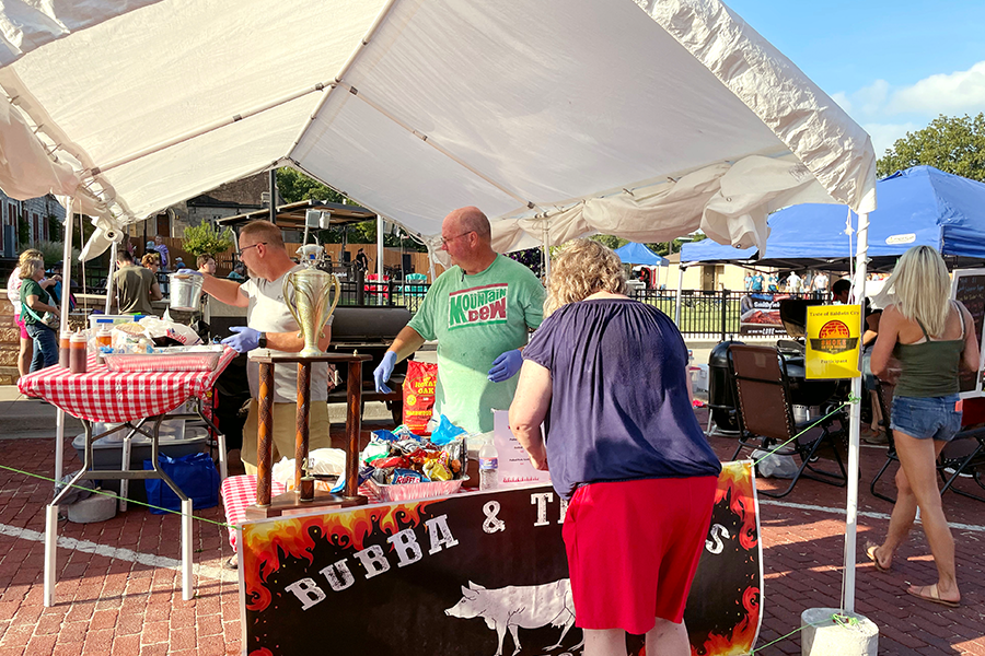 Bill Bridges and Dale Knepper of Bubba & The Boys Barbeque prepare a pulled pork sandwich for a customer. Bridges and Knepper have competed at a variety of locations around the Baldwin City area including Paola, Gardner, Olathe, Lansing and more.