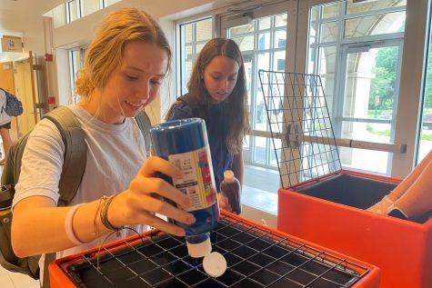 Freshman Olivia Chrisman decorates a frisbee during SAC