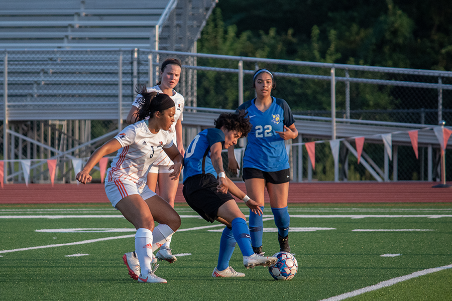 On the offense, Junior Anna Chieu works to gain control of the ball.
