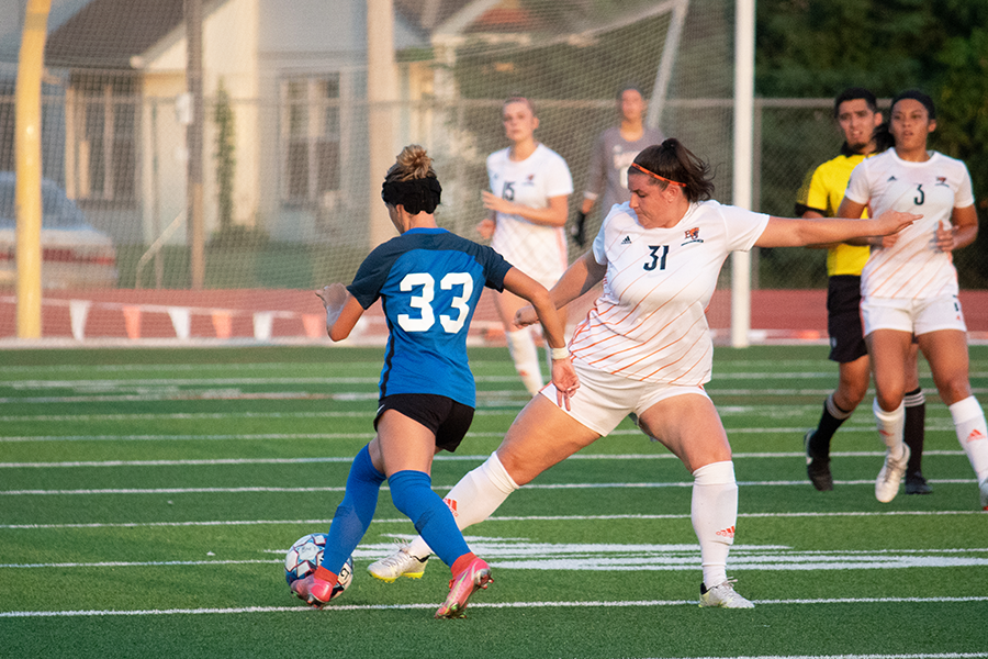 After scoring the first goal of the game, Junior Melissa Siegel attempts to steal the ball from Bethany College.