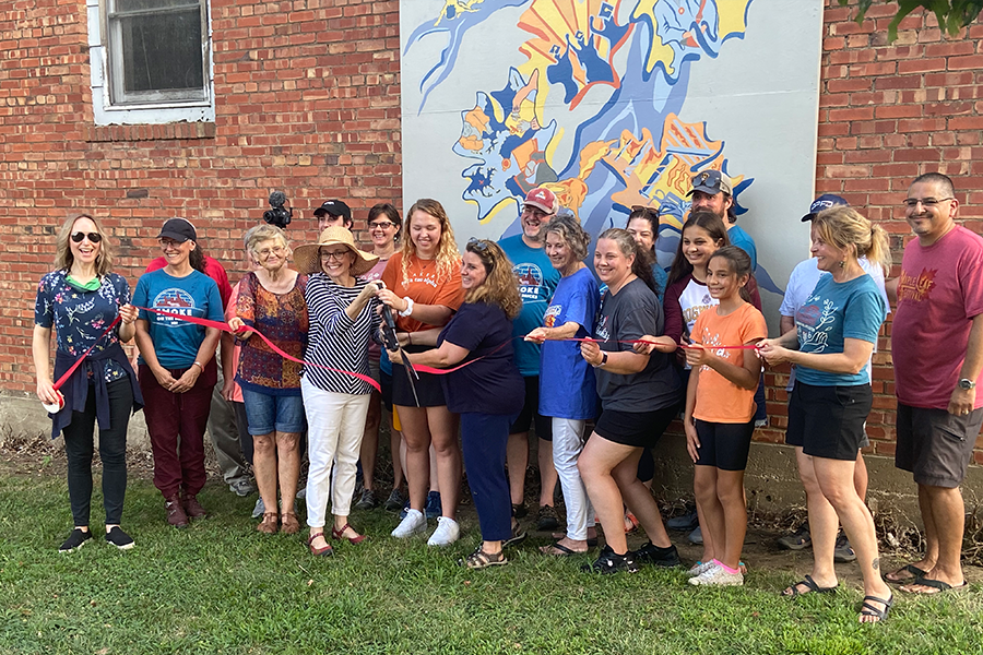 On Aug. 20, the Baldwin City Mural committee unveiled their newest creation. Everyone who contributed to the mural was asked to be a part of the official ribbon cutting.