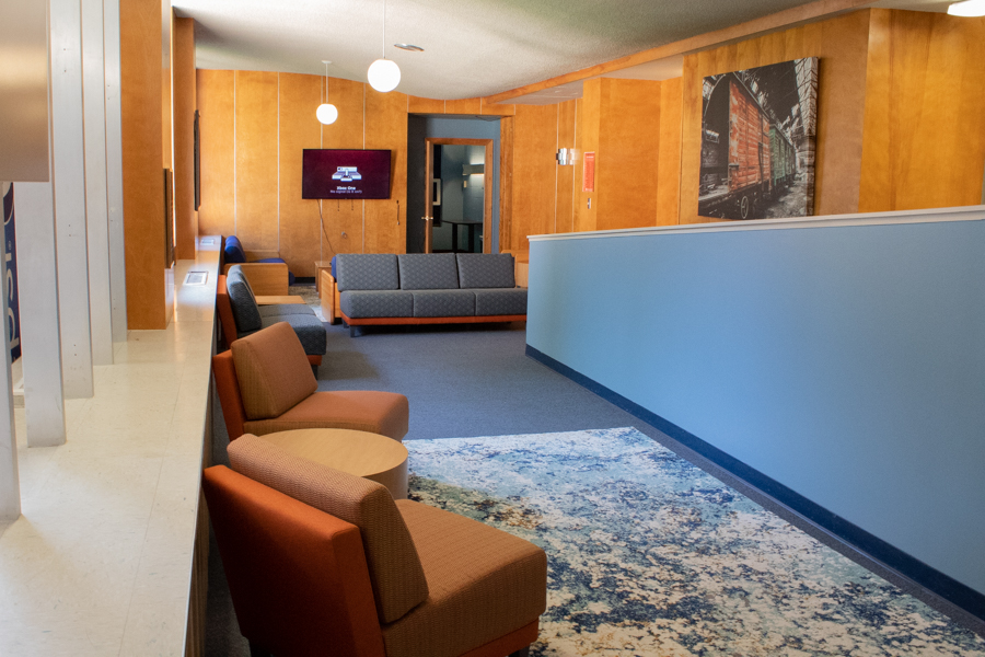 Chairs, rugs, and decor were added to the lobby for a new place for residents to relax.
