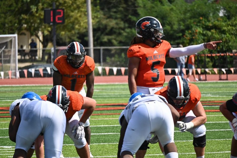 Marco Aguinaga and Senior JD Woods focus in for the next play to earn another Baker first down.