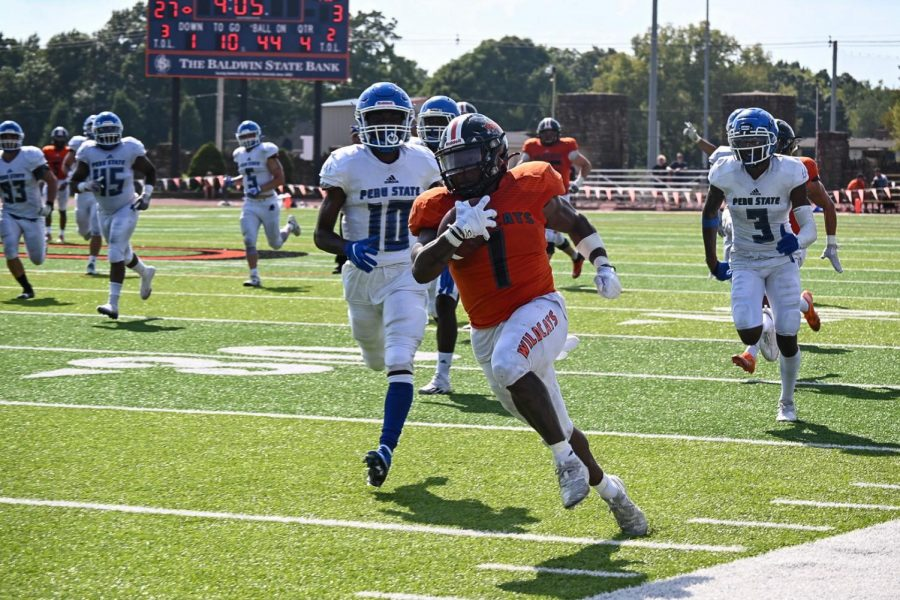 Senior JD Woods travels 56 yards, scoring another touchdown. Woods made the score 33-3 in the fourth quarter.