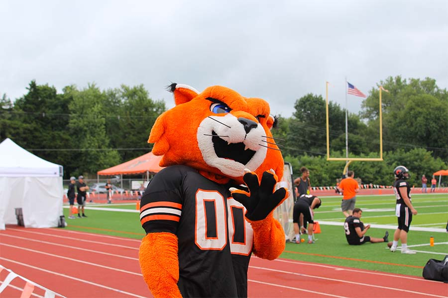 Wowing the crowd! Baker mascot Wowzer the Wildcat hypes up fans during Baker's game against William Penn.