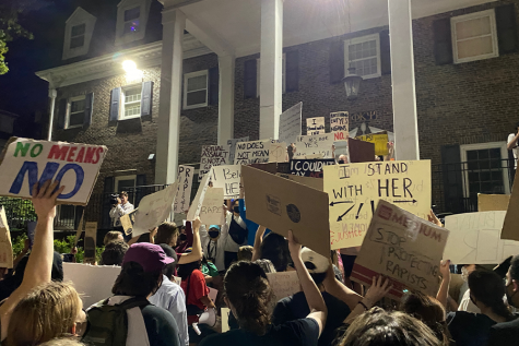 Protesters outside the Phi Kappa Psi house at the University of Kansas on Sept. 14 call for University action against the fraternity after an alleged sexual assault occurred over the weekend.