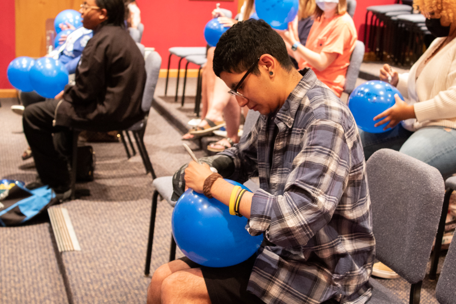 Senior Joey Jimenez engages in the activity by writing two negatives and four positives about himself, along with what he believed people actually thought of him. The balloons were then passed around the room for discussion.