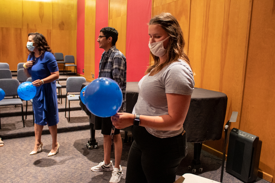 Assistant Director of Student Activities Kaitlyn Powell reads another persons balloon after throwing her own balloon around the circle.