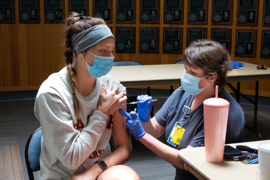 Freshman Allisyn Frank receives her final dose of the Pfizer vaccine in Collins Gym. On Sept. 20, Baker held its third vaccine clinic in hopes of raising the vaccination rate to 85% campus wide.