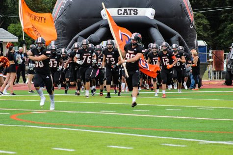 The Baker Wildcats enter the field for the start of the game against the Graceland Yellow Jackets on Oct 2.