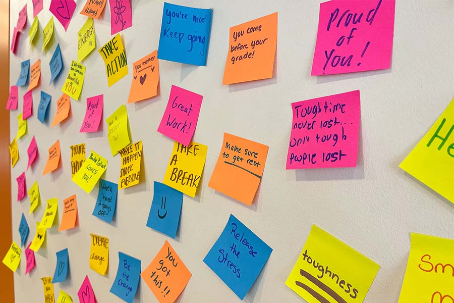 Students post words of encouragement for midterms on the wall inside the Student Union.