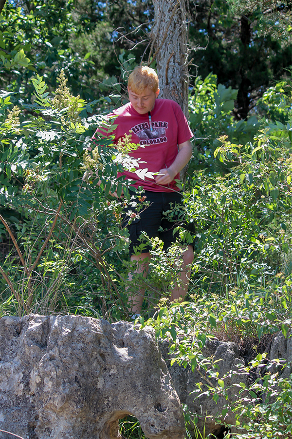 Junior David Popp works out in the field collecting samples for the team.